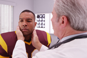 football player examined for concussion